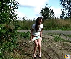 Raunchy teenage candy pees on an empty dirt road