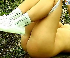 Lustful slut will play with her slit sitting on the stump until she gets completely satisfied.