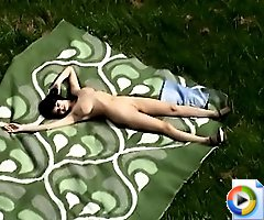 Hidden camera clips of a nude sunbathing chick