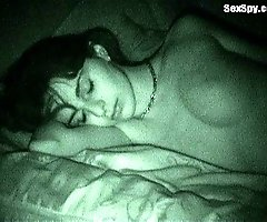 See a brunette sleeping nude with Night Vision